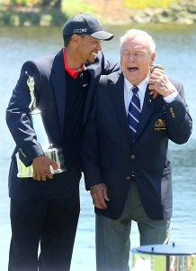 25 MAR 2013:   Tiger Woods shares a laugh with Arnold Palmer as Woods holds the Arnold Palmer Invitational trophy after winning the Arnold Palmer Invitational at Arnold Palmer's Bay Hill Club & Lodge in Orlando, Florida.
