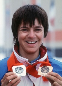 French skier Perrine Pelen smiles as she shows her two Olympic medals, 18 February 1984 in Sarajevo, at the Winter Olympic Games. Pelen won the silver medal in the slalom, 17 February, and the bronze medal in the giant slalom, 13 February.   AFP PHOTO (Photo credit should read STAFF/AFP/Getty Images)